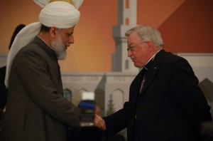 Bishop and Imam shaking hands