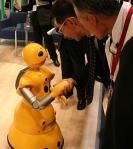 Companion robot shaking hands with a human