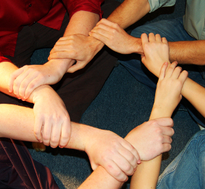 Linking hands in a circle