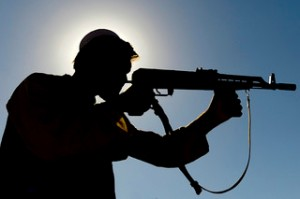 silhouette of Afghan fighter with gun