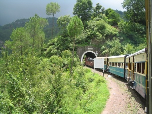 train disappearing into tunnel