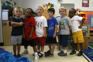 Diverse schoolchildren standing in a row