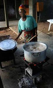 African woman cooking on coals