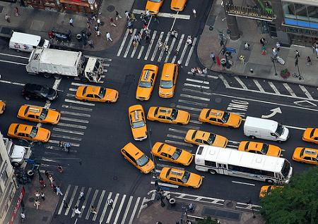 stream of taxis seen from above
